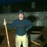 Man, shovel and wheelbarrow.